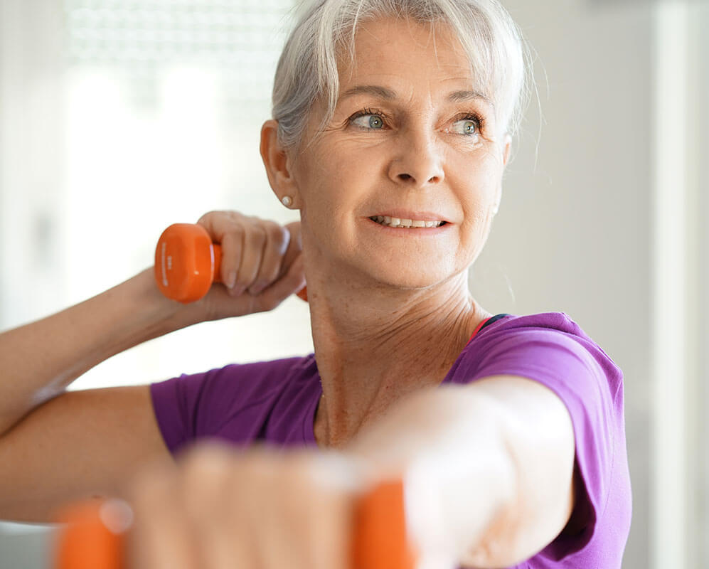 Middle aged woman working out in a gym.