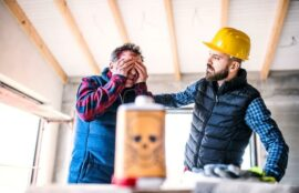 Man on a construction job site with chemicals in his eyes
