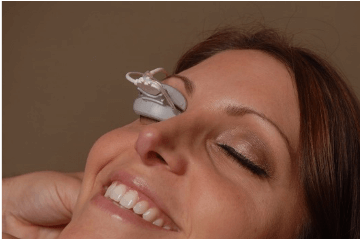 Woman getting lipiflow treatment