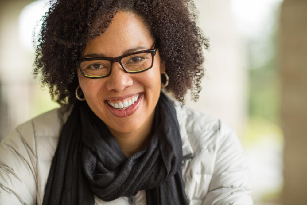 middle-age woman wearing glasses smiling