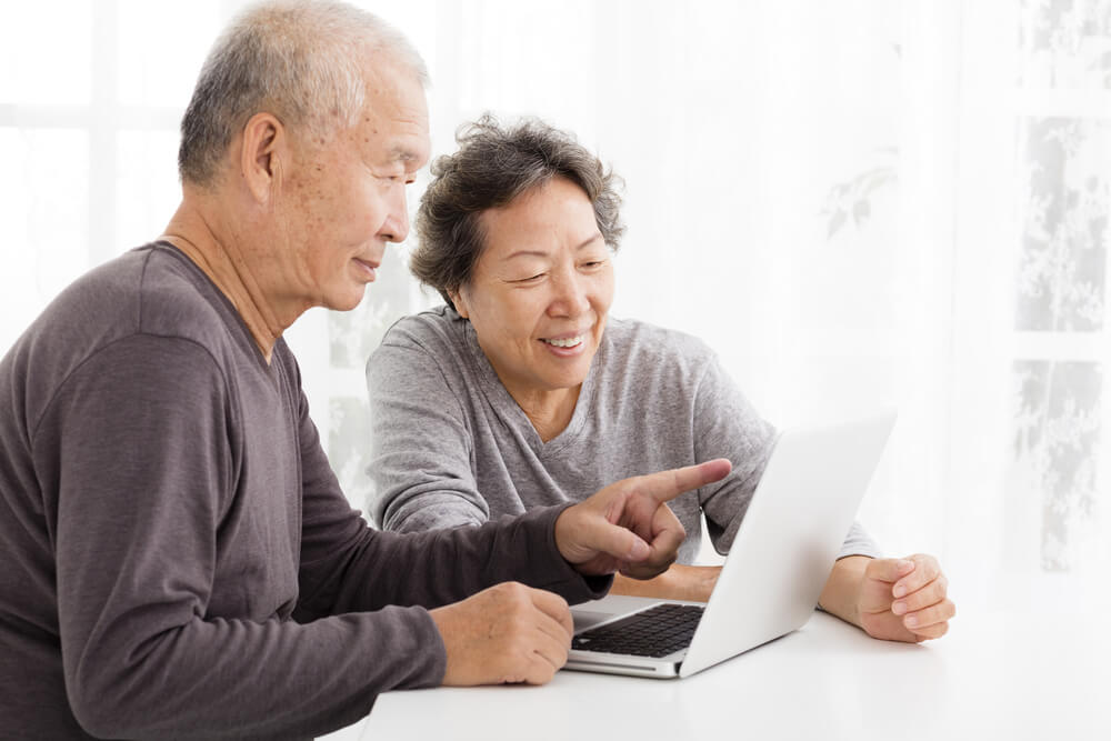 Older couple looking at laptop