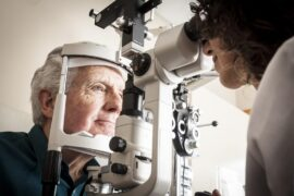 Man getting an eye exam from a doctor
