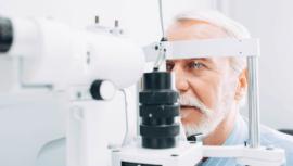 Man getting eye exam from a machine