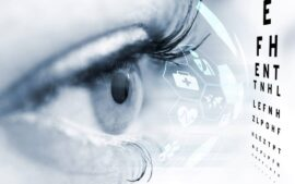Closeup of eye with illustrated futuristic icons and an eye chart
